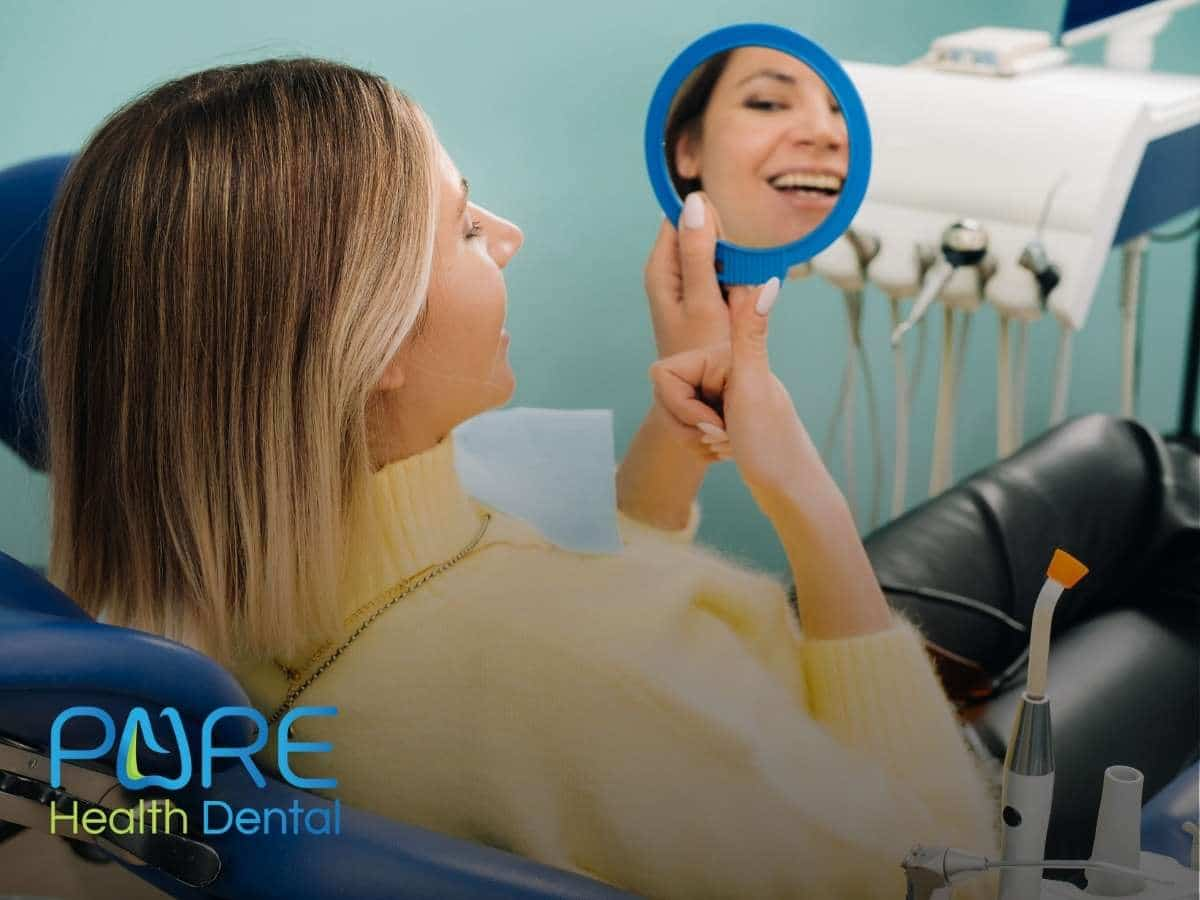 A woman with a beautiful smile in the dentist office in Bucyrus, OH.