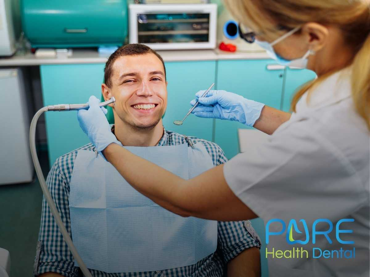 A men in a dental office checking his dental implants Massillon, OH.